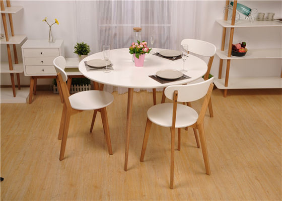 China White Round Solid Wood Dining Table Sets Wooden Table And Chairs Simple Style supplier