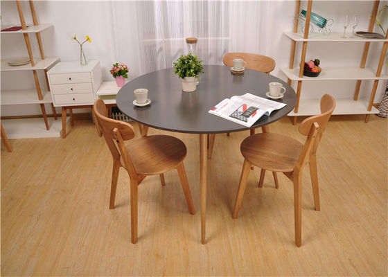 China Practical Black Top Round Kitchen Table And Chairs , Modern Natural Wood Dining Table supplier